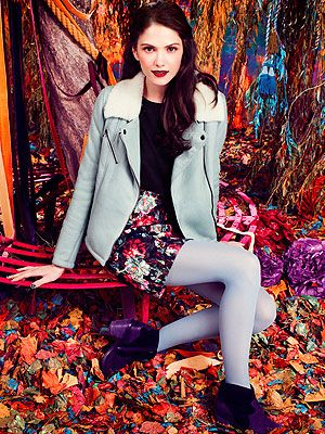 <p>Light blue leather shearling jacket £350<br />Floral skirt £40<br />Ankle boots £68<br />Black curve neck tee £18</p>