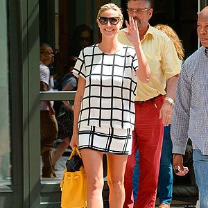 <p>You know how much we love monochrome here at Cosmo, and Heidi Klum simply nailed the trend as she was spotted out and about in New York on Wednesday. The Project Runway model oozed city chic in a checked black and white shift dress, which she wore with black heels and a yellow tote. Love.</p>
