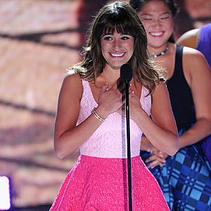 <p>Lea Michelle made the difficult decision to make her first public appearance following the sad death of boyfriend Cory Monteith at the 2013 Teen Choice Awards.</p><p>Wearing a hot pink hoop skirt, baby pink shirt, and her 'Cory' necklace, Lea look truly stunning during her emotional speech.</p>