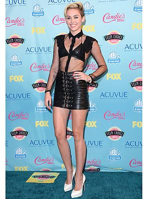 <p>Miley Cyrus was back to her bad-girl style for the 2013 Teen Choice Awards.</p> <p>The We Can't Stop singer wore a sheer Saint Laurent shirt over a leather bralet with a black leather buckle-up mini skirt from the AW13 collection.</p> <p>She wore Saint Laurent Janis pumps plus gold jewels; standard rock chick behaviour from Miley, really - but did she deserve her Choice Style Icon award? We wonder...</p>