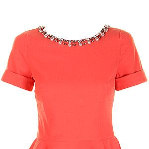 """<p>Just because the sun isn't shining doesn't mean you can't add a pop of colour to your wardrobe. This peach peplum top with embellished neckline is flattering to any body shape and will lok great worn with jeans or a pencil skirt.</p><p>Jessica top, £55, <a href=""""http://www.darlingclothes.com/product/darling/jessica-top/7174/"""" target=""""_blank"""">Darling</a></p>"""