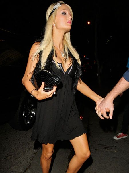 "Despite Paris Hilton's recent claim that partying and going out to clubs was beginning to feel too ""brutal"", here's the socialite dressed up with an impressive cleavage, er, partying and going out to clubs. In particular, Club Voyeur in West Hollywood..."