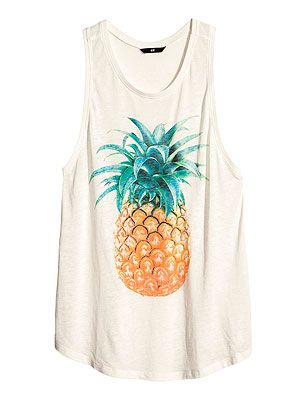 """<p>The tropical trend was big news this season. If you don't want to go for the full-on print, pick a plain white T-shirt with a single pineapple on it – versatile enough to wear with denim cut-offs or a print skirt.</p> <p>Top with a print, £12.99, <a href=""""http://www.hm.com/gb/product/15364?article=15364-A"""" target=""""_blank"""">H&M</a></p>"""