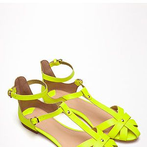 """<p>There's no better way to stand out from the crowd at V festival than with neon accessories. Start with your footwear in the shape of acid yellow sandals and work your way up with neon jewellery or sunglasses.</p><p>Sandals, £19.99, <a href=""""http://www.bershka.com/webapp/wcs/stores/servlet/product/bershkagb/en/bershkasales/160506/2853071/Bershka%2Bcolour%2Bsandals/097"""" target=""""_blank"""">Bershka</a></p>"""