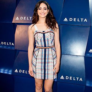 <p>Although Emmy Rossum isn't spotted on the red carpet very often, when she does make an appearance, she's usually spot on with her fashion. Yesterday was no exception as she attended the Delta Air Line summer celebration in Beverly Hills. The actress fitted her petite frame in a powder blue and coral gingham check mini dress, which she teamed with pale coral heels. Cute and chic.</p>