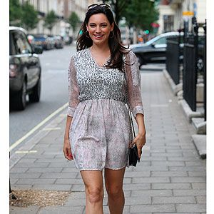 <p>Kelly Brook was the epitome of laid back summer style as she took a stroll in London on Wednesday. The model wore a grey patterned dress with sheer sleeves, teamed simply with pastel pink ankle boots and a retro style black clutch.</p>