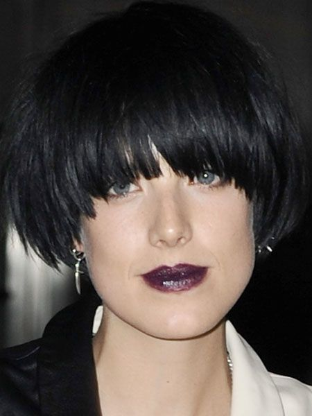 The trend receptive star wears a deep purple lip stain and lends some glamour to the gothic trend