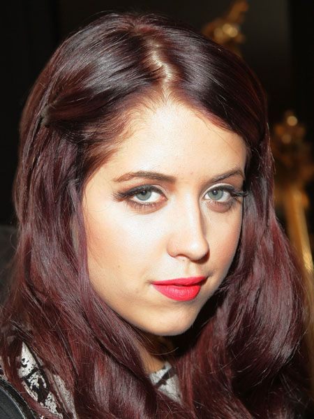 Peaches took the trend to her tresses, sporting a rich plum hair hue