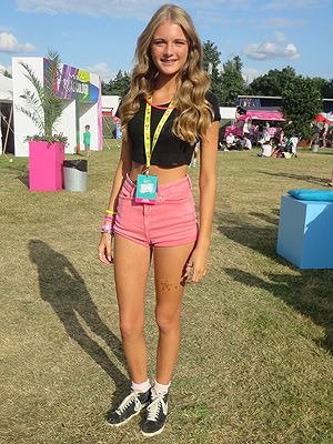 <p>Ellis erred on the right side of girly at V Festival. Showing off her toned, tanned limbs in too-cute pink shorts and a black crop-top, she added to edge to her look with a pair of well-worn Nike Blazers - and we love her frilly ankle socks!</p>