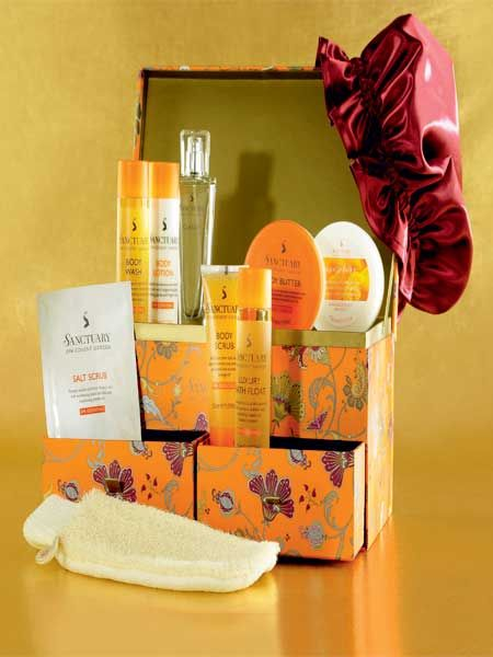 """<p>If you can't afford to splash out on a spa break for the two of you, do the next best thing and get her this perfect pamper pack from the Covent Garden spa. Inside the pretty box (perfect for storing makeup afterwards) is indulgent skincare and everything she'll need to recreate a spa experience at home including a scrub, body butter, body soufflé and eau de toilette.<br /></p><p><a target=""""_blank"""" href=""""http://www.thesanctuary.co.uk/deluxe-beauty-box-details.htm""""><br /></a>£35, <a target=""""_blank"""" href=""""http://www.thesanctuary.co.uk/deluxe-beauty-box-details.htm"""">www.thesanctuary.co.uk</a><br /><br /></p>"""
