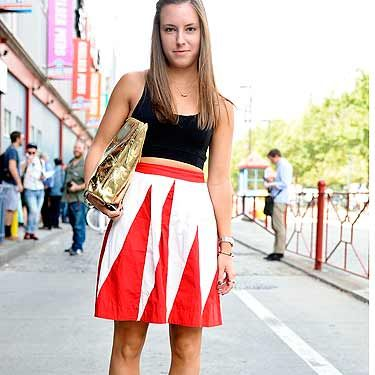 <p>Theresa adds a pop of colour to her outfit with a statement Anthropologie skirt and metallic Phillip Lim bag. We LOVE.</p>