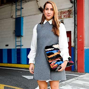 """<p>Mariana Cantu works the preppy look in a grey pinafore dress and white JW Anderson shirt - perfect for the <a href=""""http://www.cosmopolitan.co.uk/fashion/shopping/back-to-school-winter-fashion?click=main_sr#fbIndex1"""" target=""""_blank"""">'going back to school'</a> style.</p>"""
