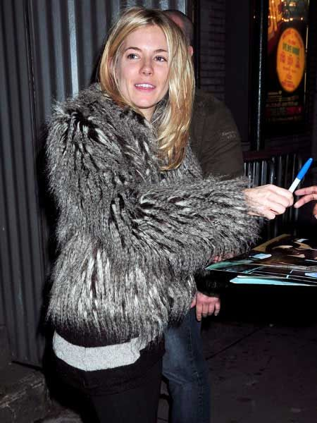 Sienna Miller, bare faced but still beautiful, was wrapped up warm in a faux (we're hoping!) fox fur coat in New York after her stage performance in 'After Miss Julie' in New York.