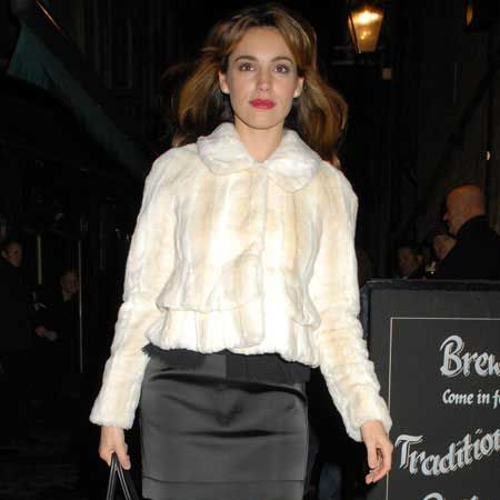 Kelly Brook went all regal and Snow Queen on us with bright red lips and a sparkling white fur coat as she left the Noel Coward Theatre, where she is currently appearing in the West End production of 'Calendar Girls'...