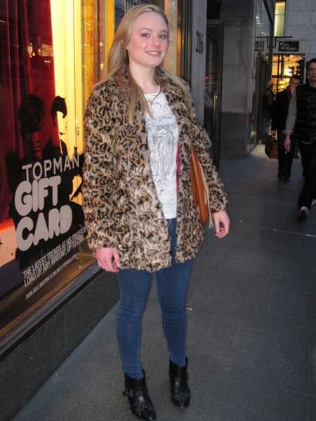 <p> </p><p><em>Coat, River Island</em><br /><br />We love how she's teamed her faux fur coat with skinny denim, studded biker boots and fringe bag...all our fav trends in one fab look!<br /><br /></p>