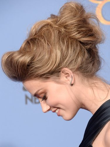 "<p>Amber turned heads with a stunning architectural up-do. The baggy quiff, the softly crafted bun and the wispy strands falling loose were a work of art. We also adored her nude lippy which didn't compete with her tresses for the limelight.</p> <p><a href=""http://www.cosmopolitan.co.uk/fashion/news/golden-globes-red-carpet-dresses"" target=""_blank"">GOLDEN GLOBES 2014 RED CARPET PICTURES</a></p> <p><a href=""http://www.cosmopolitan.co.uk/beauty-hair/news/trends/celebrity-beauty/best-golden-globes-hair-makeup-beauty"" target=""_self"">THE EVER BEST GOLDEN GLOBES BEAUTY LOOKS</a></p> <p><a href=""http://www.cosmopolitan.co.uk/beauty-hair/news/trends/celebrity-beauty/celebrity-nail-art-manicures"" target=""_blank"">THE BEST GOLDEN GLOBES NAIL ART PICTURES</a></p>"