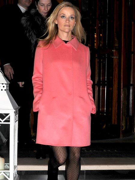 Reese Witherspoon was pretty in pink as she left her hotel in London. The Hollywood actress is currently over in the UK for a press conference in the Commons calling for more Government help for victims of domestic violence.<br /><br />