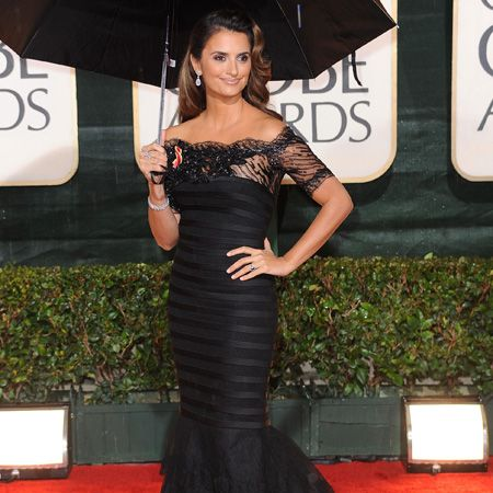 The NINE star smouldered in a dramatic black lace gown by Giorgio Armani Privé accessorised with Chopard diamonds