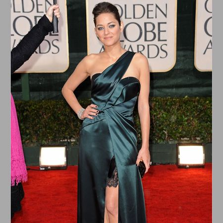 Her co-star wore a deep teal Christian Dior dress with sexy Jimmy Choo sandals <br />