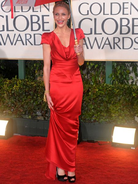 Cameron went bold in a red satin gown by Alexander McQueen with classic black platforms and minimal accessories
