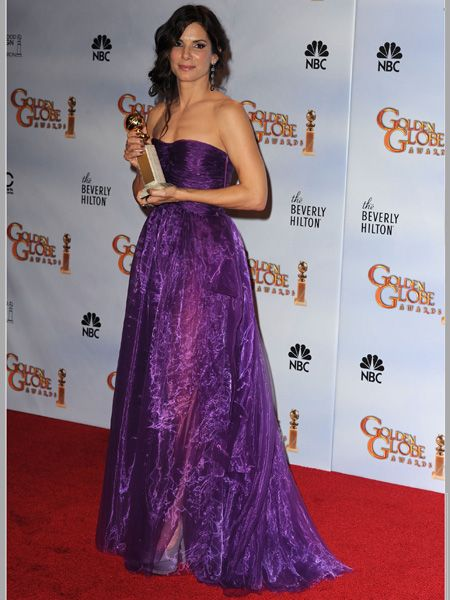 Sandra, dressed in a violet Bottega Venetta gown, won Best Performance by an Actress in a Motion Picture – Drama for <em>The Blind Side</em>