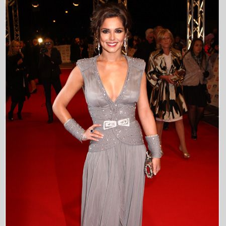 <p>Mrs Cole sparkled in a plunge-neck grey gown by Stephane Rolland accessorised with matching wrist wear and a clutch</p>
