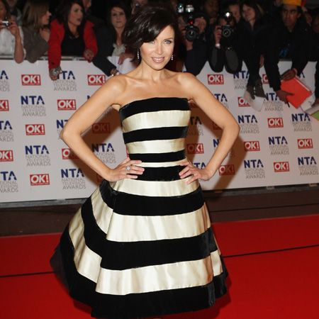 <p>The expectant X Factor presenter rocked a monochrome prom dress and red hot heels</p>
