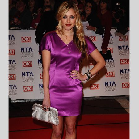 <p>The presenter showed off one of her own creations for Very.co.uk teamed with a gorgeous Angel Jackson clutch and very-now nude platforms</p>