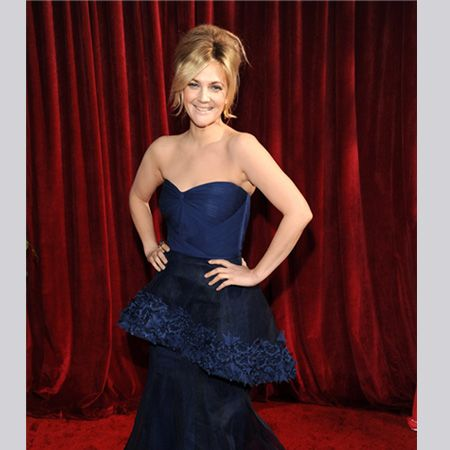 <p>Drew wore a brave peplum shaped strapless gown by Monique Lhullier but kept accessories minimal  </p>