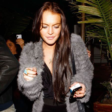"""<a href=""""tags/lindsay-lohan"""">Lindsay Lohan</a> has gone from blonde to brunette with a slight ginger tinge (or was that fake tan?) as she arrived at Madeo restaurant in West Hollywood. We prefer the star's natural auburn locks...<br /><br />"""