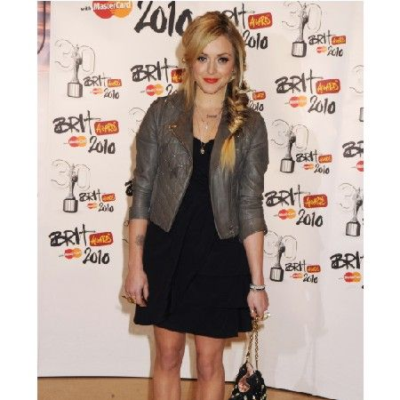 Co-presenting the awards with host Peter Kay, Fearne kept her red carpet look casual in a black dress and grey biker jacket. We loved her red lippy and messy side plait