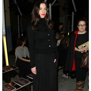 <p>Liv took her place front row for the Proenza Schouler show looking fairly nondescript, save for her pilar box red lippy that worked as a killer accessory</p>