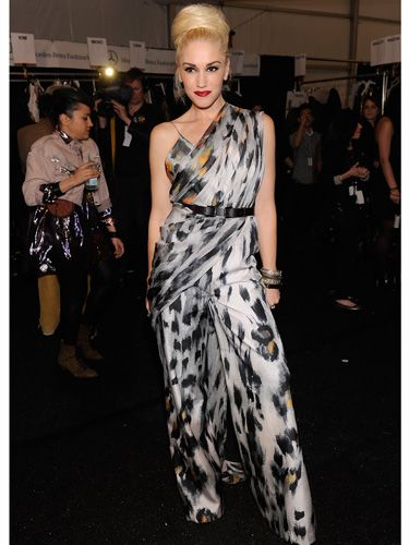 <p>In her role as designer Gwen showcased her fall L.A.M.B. collection and was the star of the show in a slinky animal print jumpsuit. Loving that fat bun too!</p>