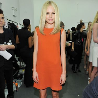 <p>The Calvin Klein fan posed backstage at the label's show working this season's brights trend like no other. That's serious orange appeal...</p>