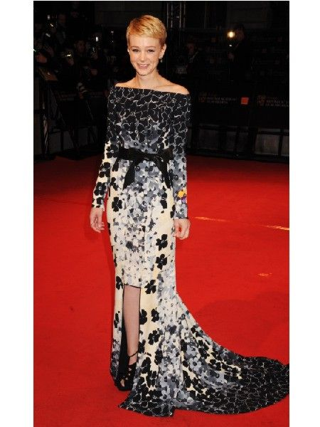 Best Actress award winner Carey wowed on the red carpet in a figure flaunting black and white fish tail dress<br />