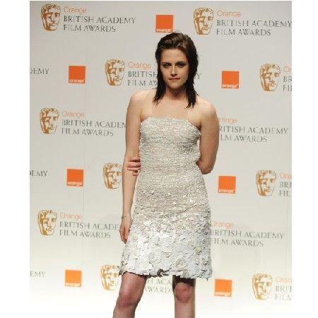 <p><em>Twilight</em> star and winner of the Orange Rising Star award Kristen wore a  white embellished dress teamed with killer platform heels</p>