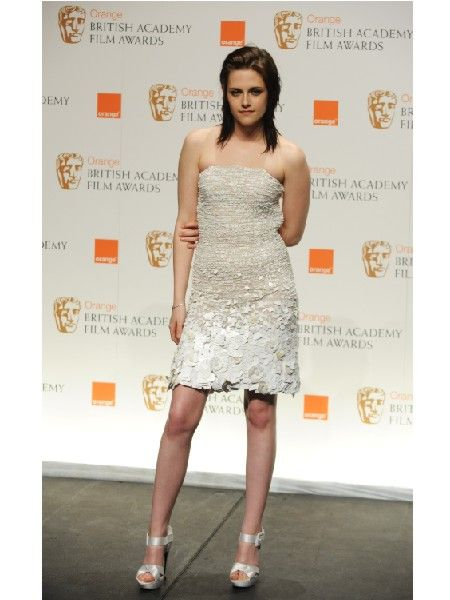 <p><em>Twilight</em> star and winner of the Orange Rising Star award Kristen wore a  white embellished dress teamed with killer platform heels</p>