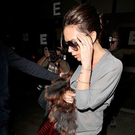 """<a href=""""tags/victoria-beckham"""">Victoria Beckham</a> did her signature hand on ear pose as she arrived back at LAX after her appearance on US chat show 'The View' in New York. The designer waded into the size zero debate to suggest skinny women shouldn't be discriminated against and that most models are naturally thin."""