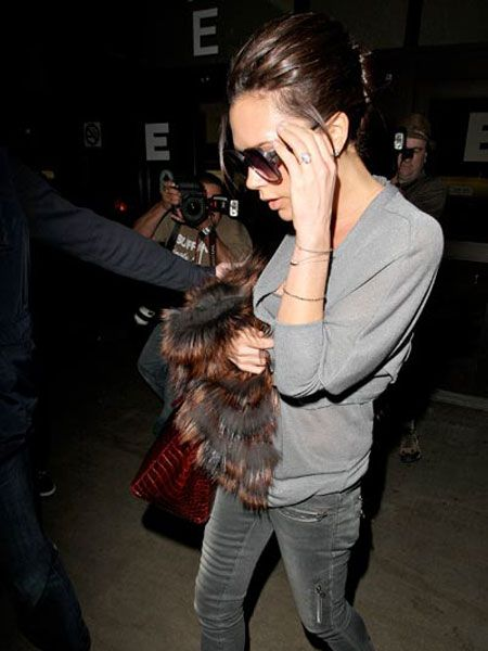 "<a href=""tags/victoria-beckham"">Victoria Beckham</a> did her signature hand on ear pose as she arrived back at LAX after her appearance on US chat show 'The View' in New York. The designer waded into the size zero debate to suggest skinny women shouldn't be discriminated against and that most models are naturally thin."