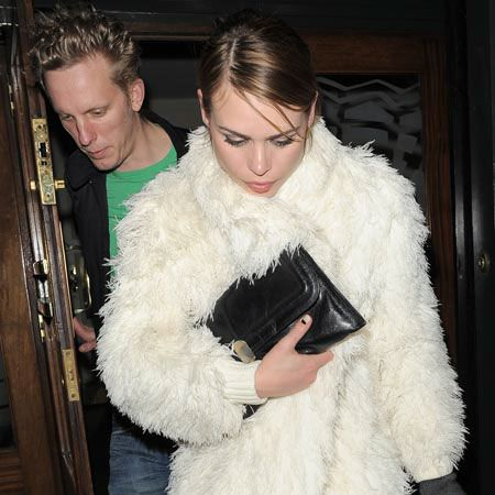 """<a href=""""tags/billie-piper"""">Billie Piper</a> and husband Laurence Fox were seen leaving the Groucho Club a few hours after actress Billy had been on the front row of the Wintle show at London Fashion Week. The star was wearing a white faux fur coat and attempting to hide her hand brace..."""