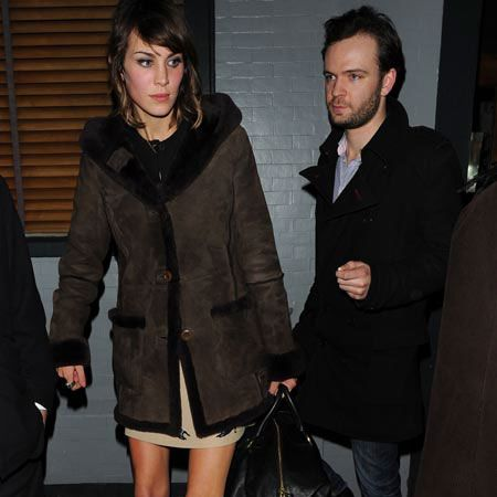 """A rather gaunt looking <a href=""""taggs/alexa-chung"""">Alexa Chung</a> was also spotted leaving the Groucho Club and being escorted into a black cab by a mystery male companion."""