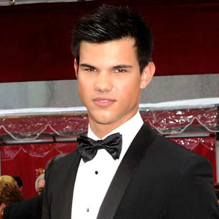 To think, a year ago there was no Taylor in our lives and now we're blessed with seeing the beauty in a tux  <br />