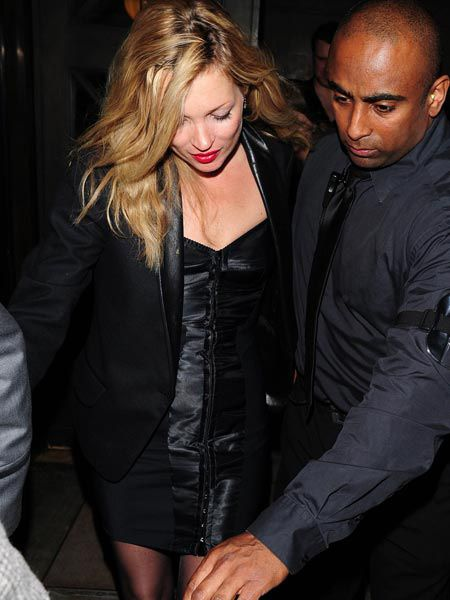 Kate Moss looked sleek and sexy in a black corseted dress and lashings of red lippy as she attended the charity 'Mummy Rocks' night for Great Ormond Street Hospital..