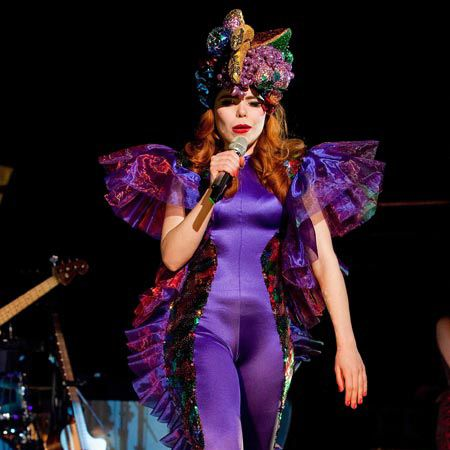 Paloma Faith was looking fruity (quite literally) as she wore the contents of a fruit bowl on her head while performing at London's Shepherd Bush
