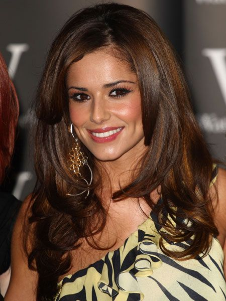 Cheryl's hair has been cut with long layers at the front to shape her heart face