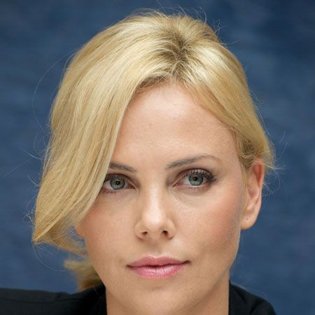 Charlize is another oval star to effortlessly switch from short to long and back again. Here she wears a loose chignon with hair at the front to highlight her cheekbones