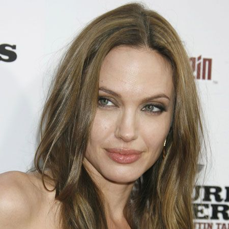 <p>With angular features, square face shapes are lucky enough to get away with most styles, and some of the most famous women in the business are blessed with a strong jaw.</p><p><strong>Left:</strong>Angelina Jolie is lucky enough to have a face shape to suit most styles, but here she's kept it simple with a centre parting and loose waves</p>