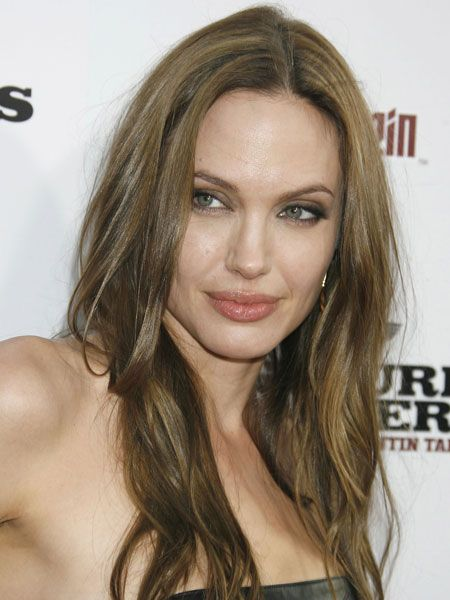 <p>With angular features, square face shapes are lucky enough to get away with most styles, and some of the most famous women in the business are blessed with a strong jaw.</p>  <p><strong>Left:</strong>Angelina Jolie is lucky enough to have a face shape to suit most styles, but here she's kept it simple with a centre parting and loose waves</p>