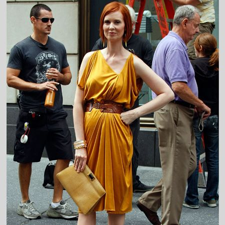<p>Carrie's not the only one on fine form, we think Miranda's never looked better than in this belted mustard frock and killer platforms</p>