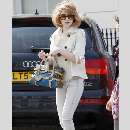 <p>Chezza's band mate Nicola knows that pale and interesting is in - teaming her off-white skinny jeans with a cream jacket and matching platforms </p>